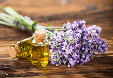 fragrant: Wellness treatments with lavender flowers on wooden table.