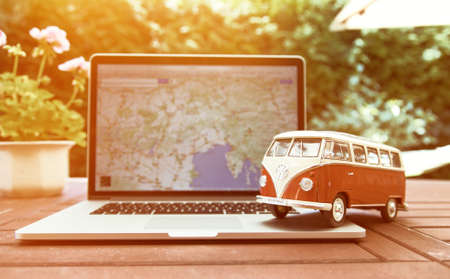 forced perspective: PRAGUE, CZECH REPUBLIC - JULY 10, 2015: Miniature VW Bulli 1962 on laptop. The cult car of the Hippie generation and it remained the status vehicle of the high wave surfers.