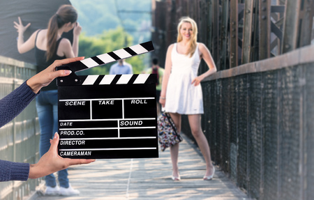 filmmaker: Clapperboard sign hold by female hands, close-up. Stock Photo