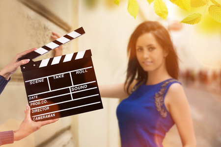 Clapperboard sign hold by female hands, close-up. Stock Photo