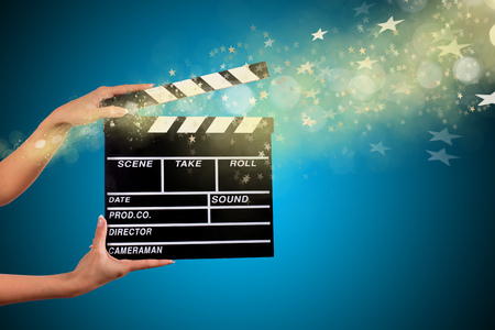 Clapperboard sign hold by female hands, close-up. Stok Fotoğraf