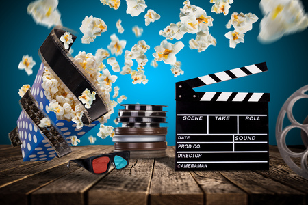 junkie: Pop-corn, movie tickets, clapperboard and other things in motion. Cinema concept.