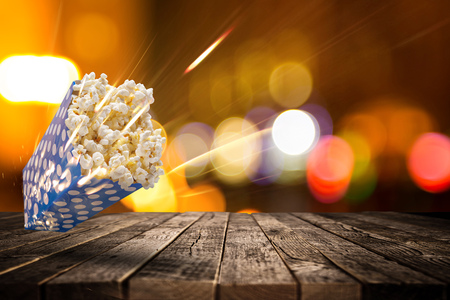 Boxes of popcorn on old wooden table, close-up. Stock Photo