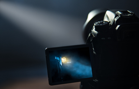 DSLR camera making video in studio. Free copy space for your text