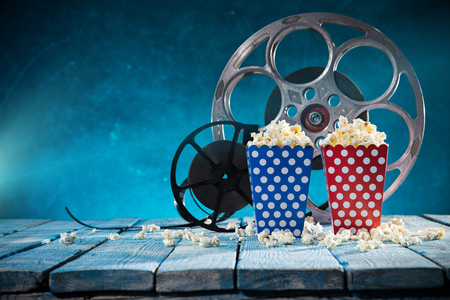 Old style movie reels with pop corn, still-life, close-up. Stock Photo