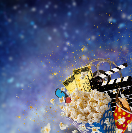 Pop-corn, movie tickets, clapperboard and other things in motion. Cinema concept. Imagens - 76488010