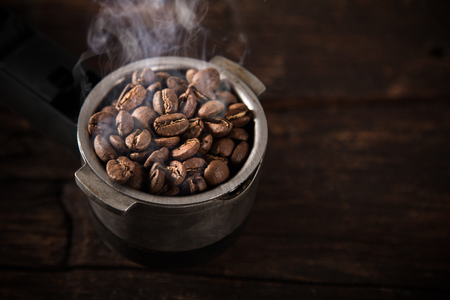 hot temper: Fresh coffee beans in coffee maker.