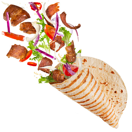 Kebab sandwich with flying ingredients. 免版税图像