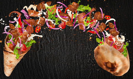 Kebab sandwich with flying ingredients. Banco de Imagens