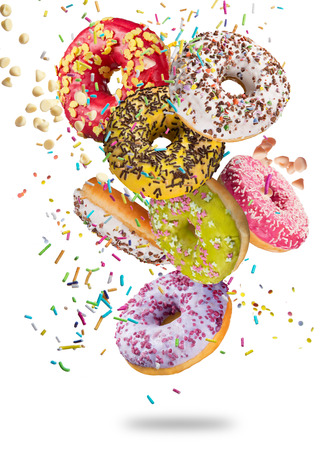 Tasty doughnuts in motion falling on white background, close-up. Stock Photo - 78814126