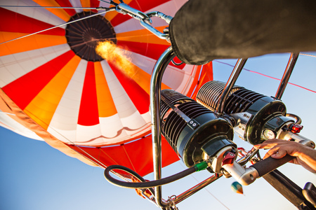 A hot air baloon rising high. Unusual perspective view.