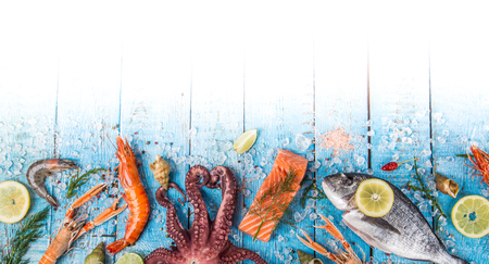 Fresh tasty seafood served on old wooden table. Banco de Imagens