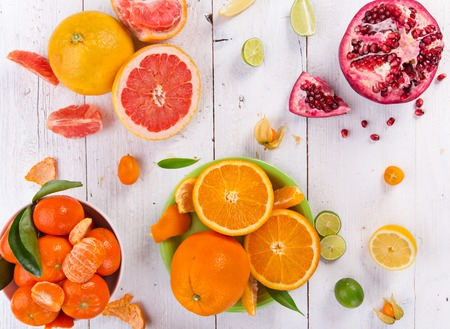 Fresh mixed fruits on vintage white wooden table. Stock Photo