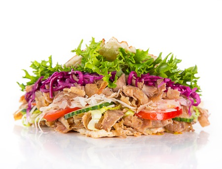 close up of kebab sandwich on white.
