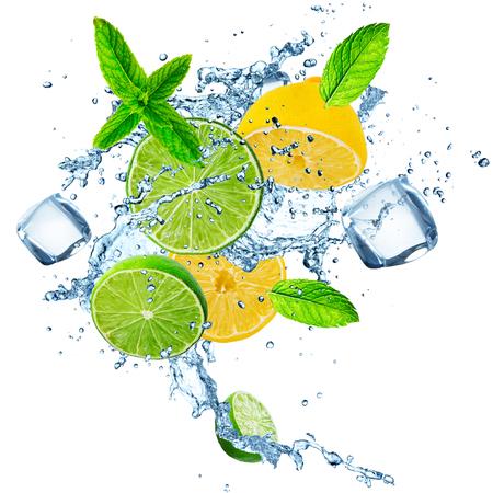 Fresh limes and lemons with water splash.
