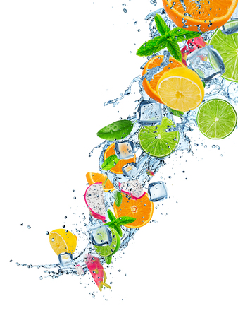 Fresh fruits in water splash on white background Stock Photo