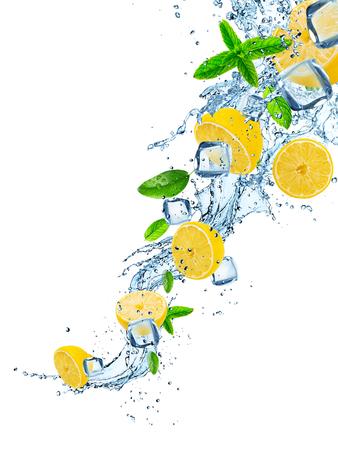 Fresh lemons with water splash on white. Archivio Fotografico