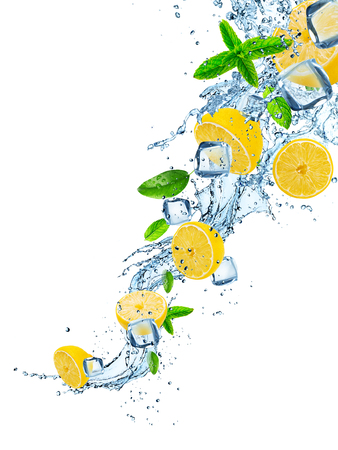 Fresh lemons with water splash on white. Stockfoto