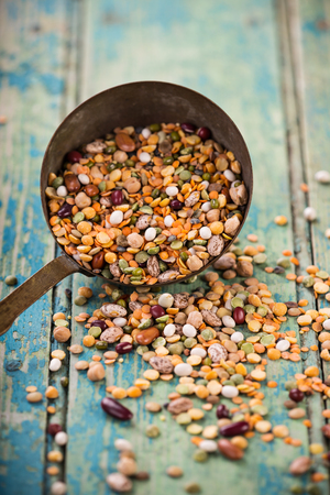 mung: Raw legume on old rustic wooden table. Stock Photo