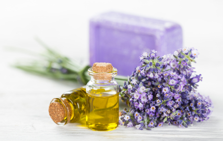 bath essence: Wellness treatments with lavender flowers on wooden table. Spa still-life.
