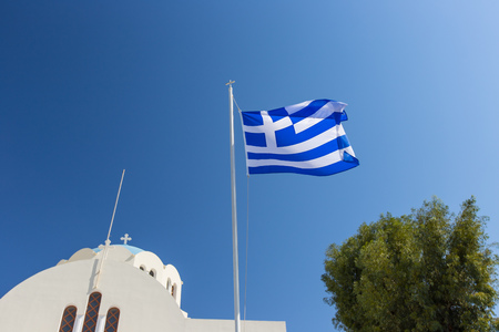 Cycladic church with greek flag. Santorini island, Greece, Europe. Stock Photo - 85258702