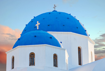 Classic view of blue dome church in Santorini. Oia Village, Greece.