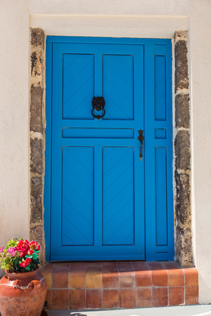 Old blue doors in Greece, Santorini island, Oia village with traditional architectures.