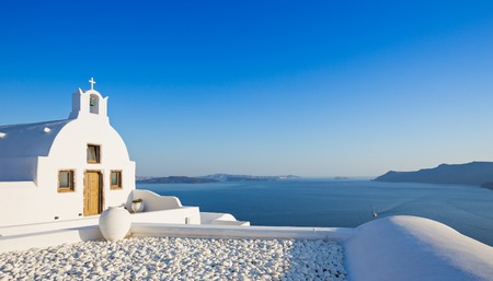 Small traditional Greek Orthodox church in Oia, Santorini. Europe. Stock Photo