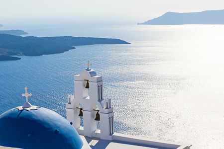 The Three bells of Fira and blue dome, Santorini, Greece, Europe. Stock Photo