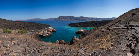 Famous volcano Nea Kameni, view of the cove. Santorini, Greece, Europe. Stock Photo