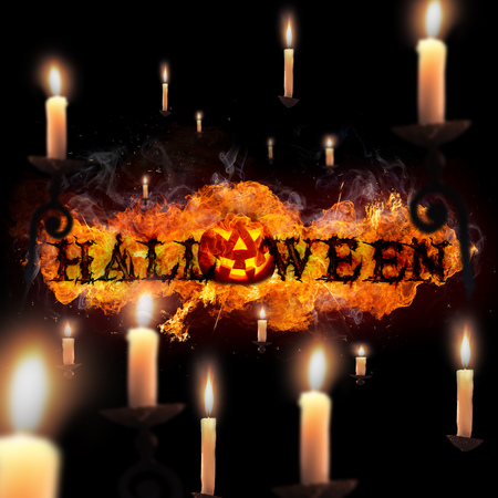 Halloween, Fire Text, pumpkin and candles on black background