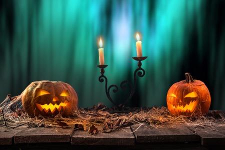 Halloween pumpkins on wooden planks.
