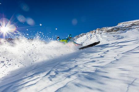 Freeride in fresh powder snow. Skiing. Stock Photo