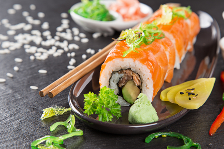 Japanese sushi set on a rustic dark background. Stock Photo