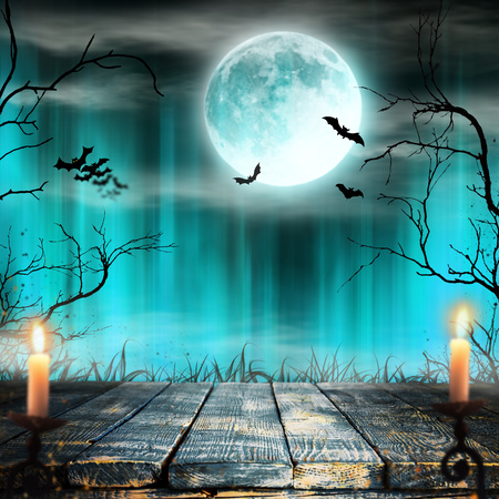 Spooky Halloween background with candles. Banco de Imagens