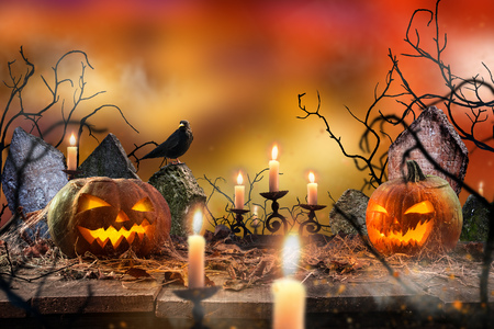 wood carvings: Spooky Halloween pumpkins on wooden planks with spooky background. Stock Photo