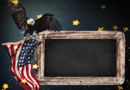 Empty wooden table with bald eagle and flag. USA national holidays concept.