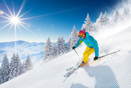 Skier skiing downhill in high mountains Фото со стока - 90235928