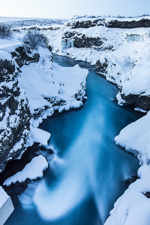 Hraunfossar waterfall in winter. One of the most popular waterfall in Iceland, Europe. Stock Photo