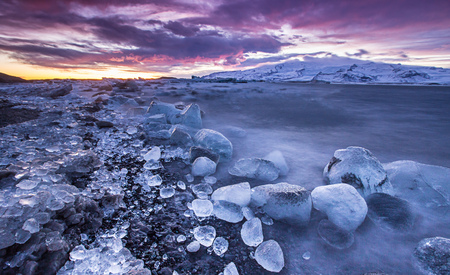 Icebergs in Jokulsarlon glacial lake during sunset, Iceland, Europe.
