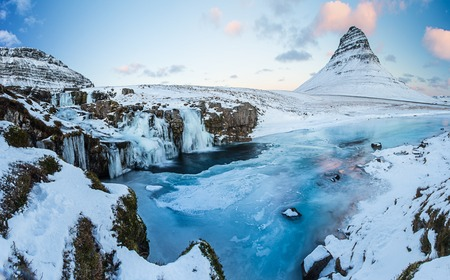Kirkjufell waterfall with mountain in winter, Iceland, Europe.