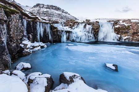 Kirkjufell waterfall with mountain in winter, Iceland, Europe.