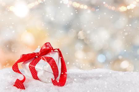 Christmas gift with blurred background, lots of copy space for your product or text.