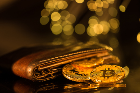Bitcoin gold coins with wallet. Virtual cryptocurrency concept.