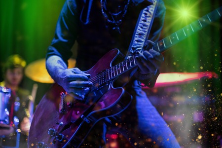 Guitarist playing on electric guitar. Rock concert stage. Stock Photo