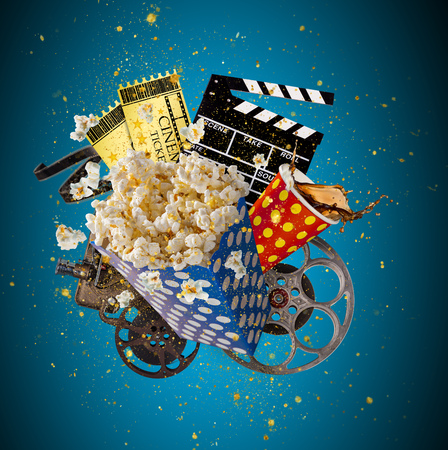 Pop-corn, movie tickets, clapperboard and other things in motion. Cinema concept. Imagens - 92951637
