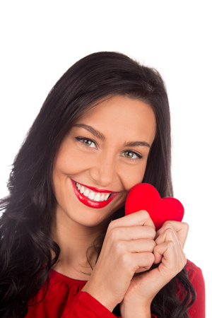 Beautiful female holding red heart, Valentine or Womens day portrait. Stock Photo