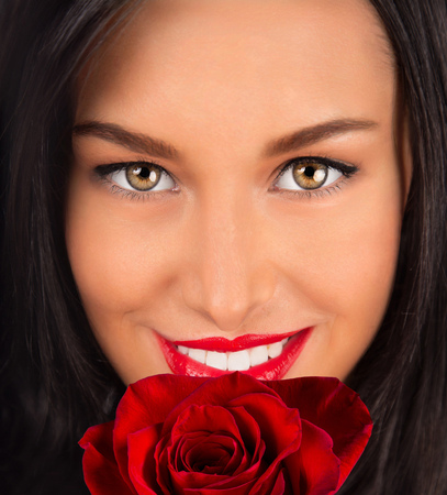 Beautiful happy female holding roses bouquet, Valentine or Womens day portrait. Stock Photo