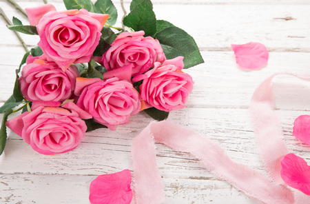 Flowers composition for Valentines, Mothers or Womens Day. Pink flowers on old white wooden background. Still-life. Stock Photo