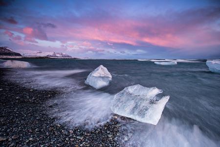 Beautiful sunset over famous Diamond beach near Jokulsarlon lagoon, Iceland, long exposure.